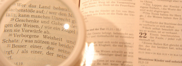 Picture of magnifying glass over a book