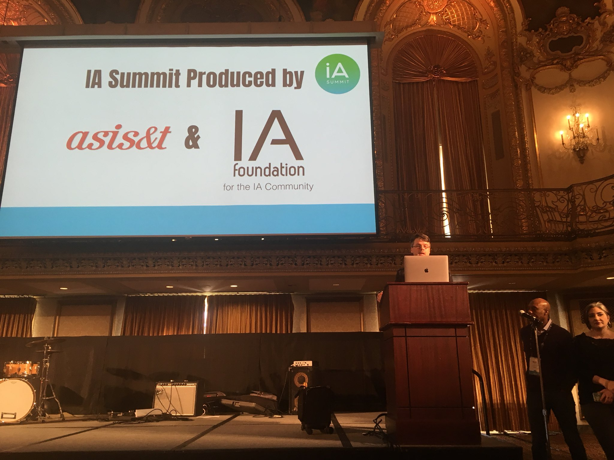 IA Summit co-chair on stage opening the conference.