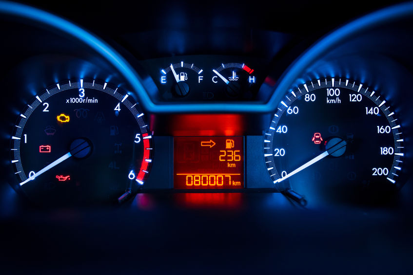 a car dashboard showing speedometer, fuel gauge, odometer, etc.