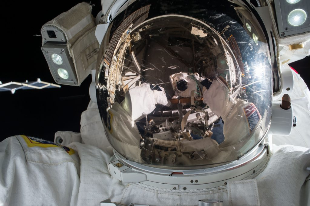 reflective-visor-of-astronaut-working-in-space