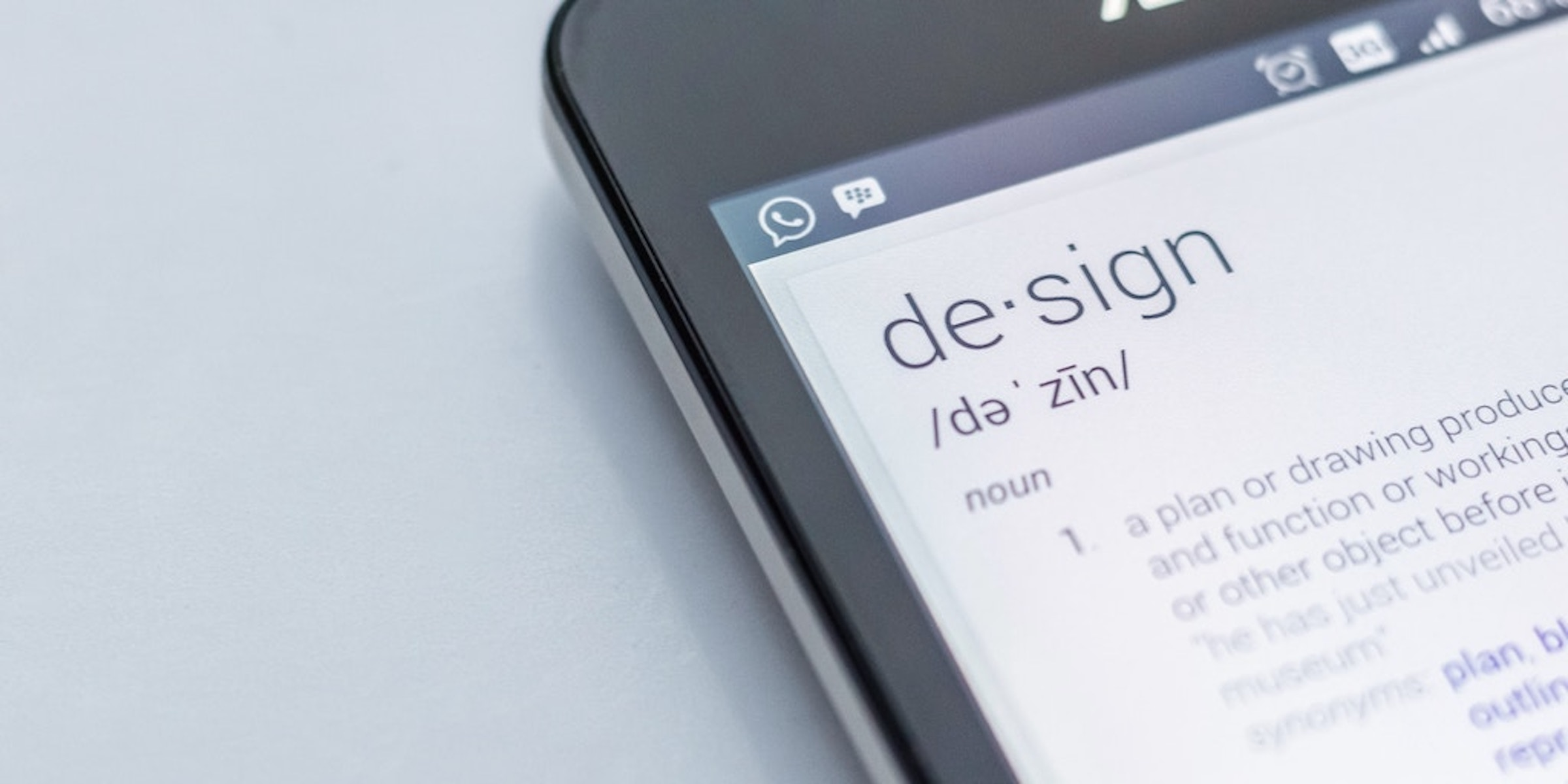 definition of design is displayed on a mobile device screen