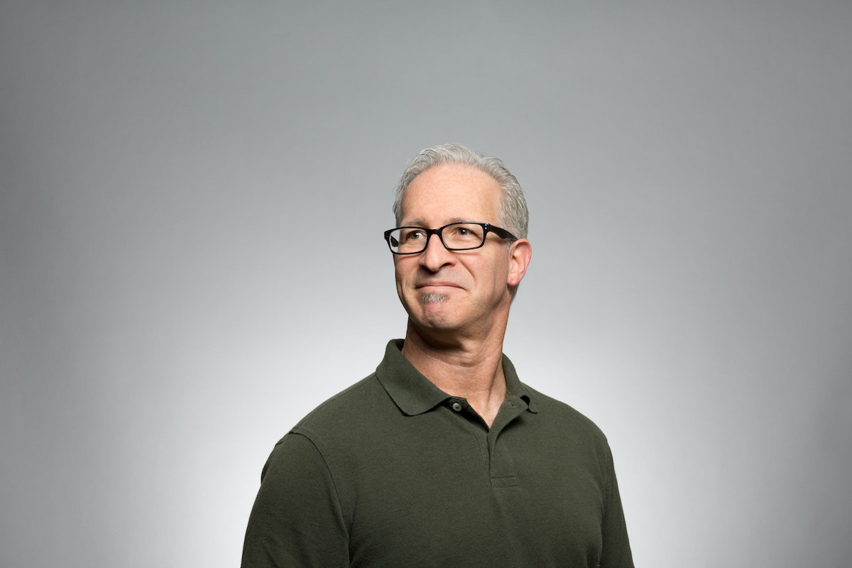 Photo of a middle-aged man with glasses